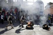 Полиция Гаити применила слезоточивый газ против протестующих